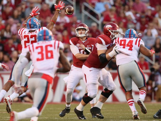 Arkansas quarterback Austin Allen had three touchdown passes through the first three quarters on Saturday against Ole Miss.