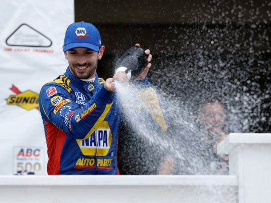 Alexander Rossi celebrates in Victory Lane after winning