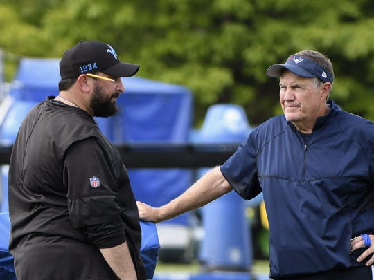 Detroit Lions head coach Matt Patricia, left, and New England Patriots head coach Bill Belichick, right, talk off to the side after a combined NFL football practice in Allen Park, Mich., Monday, Aug. 5, 2019. (Daniel Mears/Detroit News via AP)