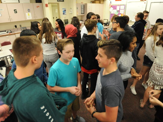 International Academy of Macomb students in a Spanish I class talk in Spanish with each other in May.