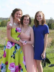Hannah King, center, poses with her younger sisters,