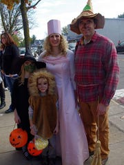 Entire families got into the spirit at last year's Webster Trick or Treat Trail. (M. Rosenberry)