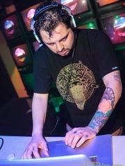 Marcus Lee, AKA Game Genie, DJ'ing at 1up.