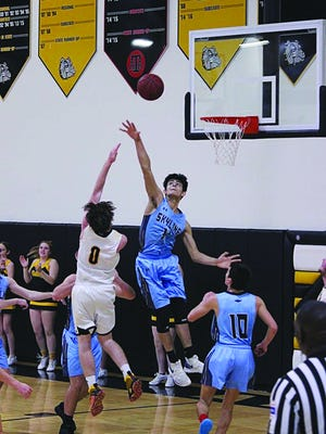 Skyline senior Eliazar Carrasco disrupts a shot in the lane in a game last week. Carrasco had three blocks, 9 points and 8 rebounds against Central Christian.