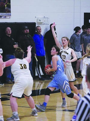 Skyline senior Sophie Bricker battles her way to the basket in a game that had players up against their own illness as well as their opponents.