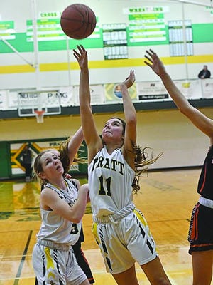 Danielle Staats (#11) shoots the game-winning shot at the buzzer Friday against the Smoky Valley Vikings in Pratt.