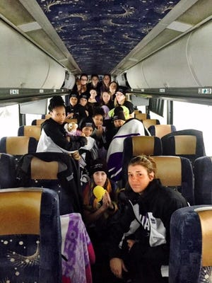 Niagara center Sam Lapszynski of Jefferson (center, with yellow toy), and her teammates have been trapped on a bus by a snowstorm since about 2 a.m.