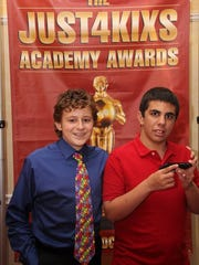 Buddy Zachary Medeiros (left), who won the Oscar for Best Supporting Buddy, posed with player Mikey Miglino (right), who won Oscar for Most Improved player.