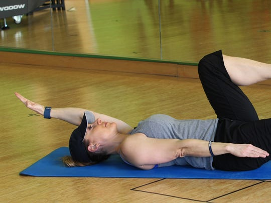 Catherine Andersen, owner and personal trainer of Adventure Boot Camp and Achieve Personal Fitness at Balance Fitness demonstrates the ending position for the dead bug exercise.