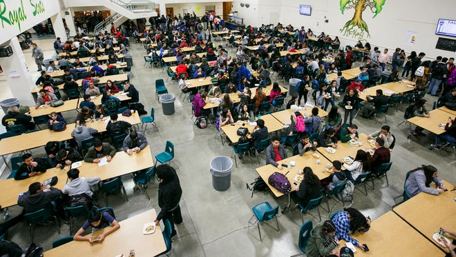 Students stream into the cafeteria for the first of three lunch periods at McKay High School on Monday, Nov. 28, 2016. McKay is one of the most overcrowded schools in the district; it was built to accommodate about 1,750 students but this year's enrollment is close to 2,400.