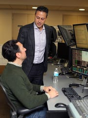 "Sean Hendelman, the Chief Executive Officer for T3 Companies chats with trader Matthew Grossman on the ""trading floor"" at the T3 Trading Group, LLC in New York, Jan. 14, 2016."