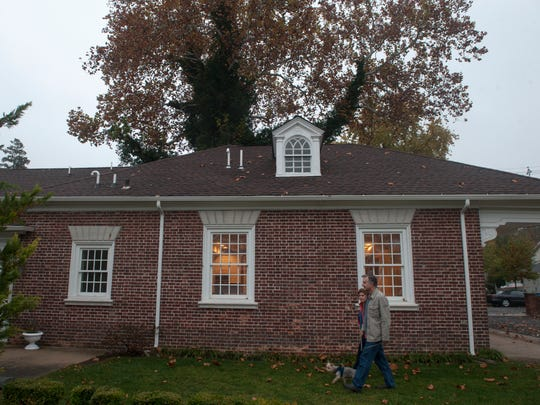 Martha Colameco and her husband Joseph Barolin walk outside the historic Carriage House in Delanco, which once was home to the carriage caretaker for the first owners of Zurbrugg Mansion.