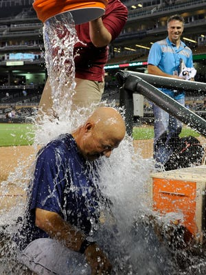 This is what a Bay Village, Ohio, boy was expecting when teens that he socialized with asked him to a house to take an ALS Ice Bucket Challenge. Here, Manager Terry Francona of the Cleveland Indians accepts the challenge Aug. 20 after a win against the Minnesota Twins.