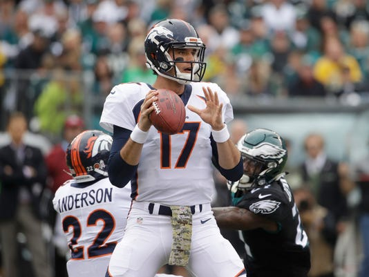 FILE - In this Sunday, Nov. 5, 2017, file photo, Denver Broncos' Brock Osweiler (17) looks to throw against the Philadelphia Eagles during an NFL football game in Philadelphia. Osweiler is expected to start for the Broncos this week against the New England Patriot. (AP Photo/Matt Rourke, File)