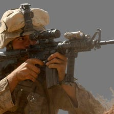 Marine soldier uses an M16 in a firefight with Taliban forces
