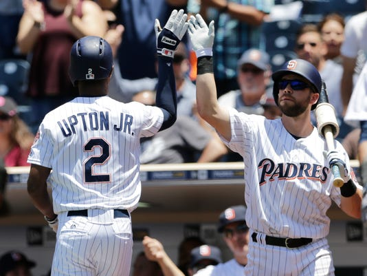 San Diego Padres' Melvin Upton Jr., left, is greeted by teammate Ryan Schimpf after hitting a home run during the second inning of a baseball game against the Miami Marlins Wednesday, June 15, 2016, in San Diego. (AP Photo/Gregory Bull)