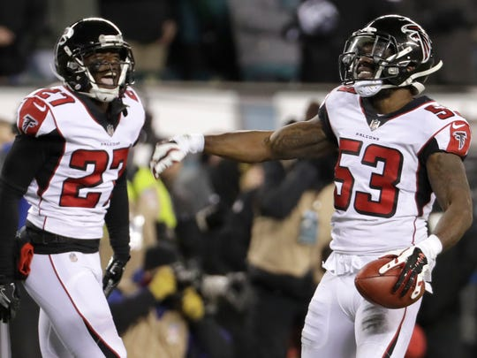 Atlanta Falcons' LaRoy Reynolds, right, and Damontae Kazee (27) react after recovering a fumbled punt during the first half of an NFL divisional playoff football game against the Philadelphia Eagles, Saturday, Jan. 13, 2018, in Philadelphia. (AP Photo/Chris Szagola)