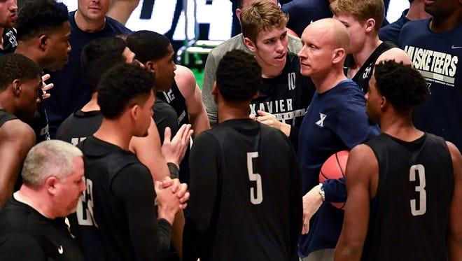 Xavier head coach Chris Mack speaks to his team during practice at Bridgestone Arena in Nashville, Tenn., Thursday, March 15, 2018.