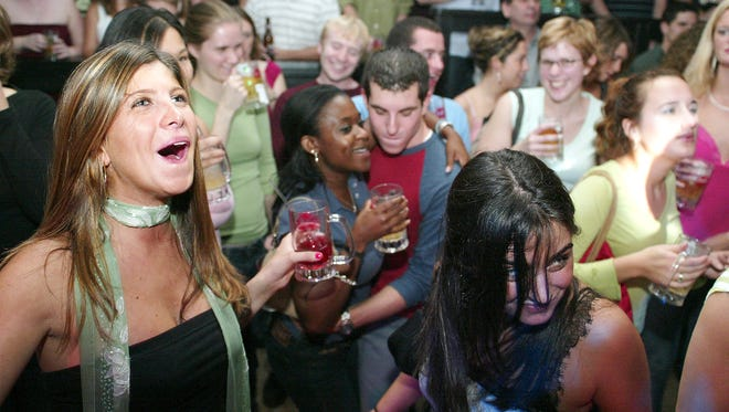 Fans fill the dance floor for mug night at the old Stone Balloon Tavern & Concert Hall in Newark for a show by Burnt Sienna on Nov. 4, 2004.