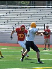 Justin Martin playing football during a junior varsity