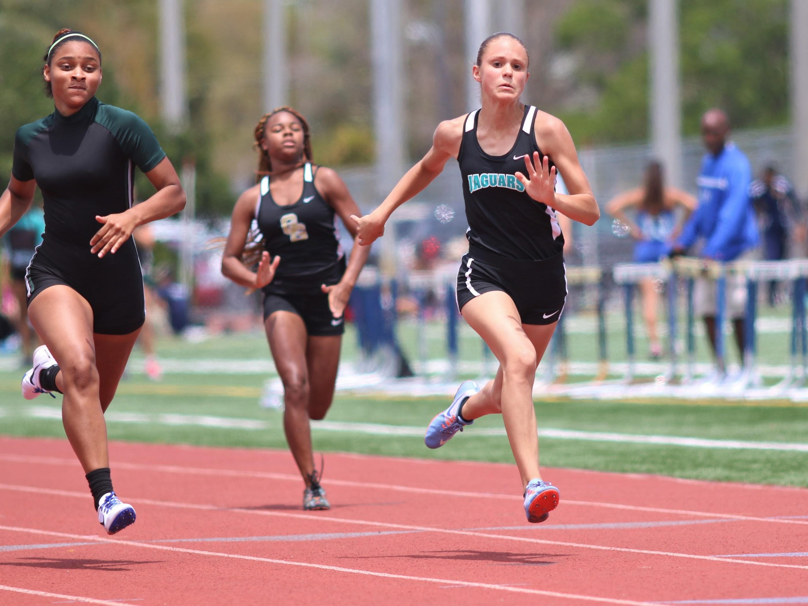 East Lee runner Mia Alfaro races in the girls 100 meter dash at Saturday afternoon's Class 3A District 12 Track meet at Naples High.