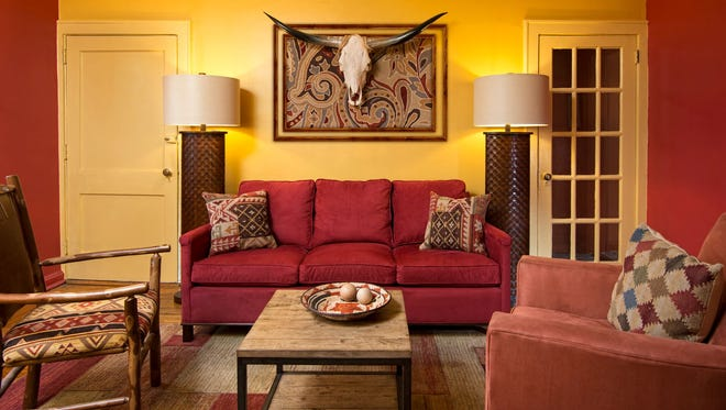 A passion for Native American heritage and the Southwest inspired the bold yellow and red palette and furnishings in what was a nondescript   living/dining area.