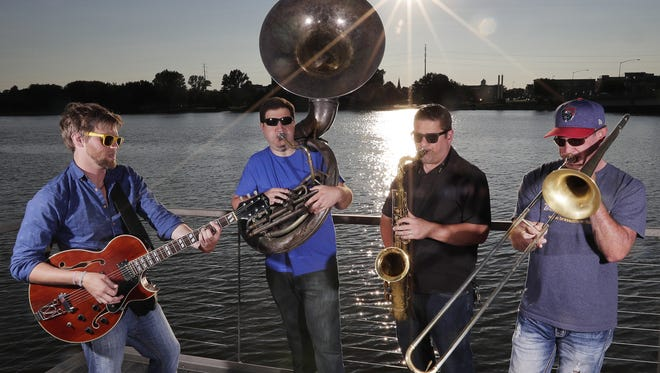 Brass Differential members, from left, Shawn Connelly, Kelly Galarneau, Steve Johnson and Bill Hill jam on CityDeck on Monday during a photo shoot. The full band will play Fridays on the Fox this week at the same location.