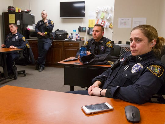 Ithaca Police Officer Jamie Buffone, right, and the