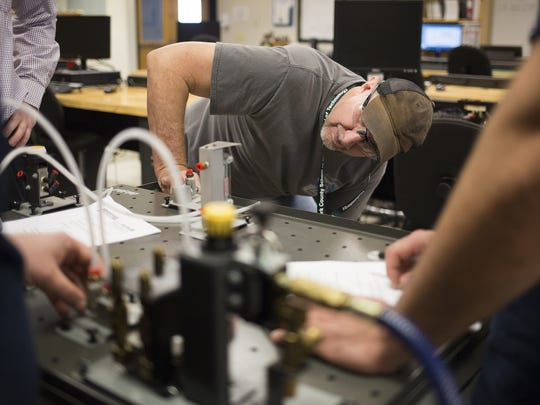 Student Stewart Trout Jr., 59, works with a pneumatics trainer during class. Instructor Kevin Schussler, 36, teaches an adult education mechatronics course at York County School of Technology.