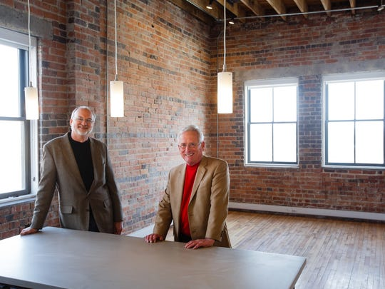 Developers of the Harbach buildings, Davis Sanders, right, and Kent Mauck, left, pose for a photo in the south building on Wednesday, Feb. 8, 2017.