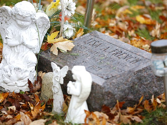 Fond du Lac homicide victim, 9-year-old Lisa Ann French, rests in Estabrooks Cemetery, Saturday November 4, 2017.