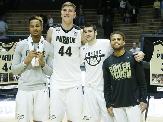 Seniors Vincent Edwards, from left, Isaac Haas, Dakota Mathias and P.J. Thompson pose for a group photo following the Boilermakers 84-60 victory over Minnesota, February 25, 2018, at Mackey Arena.