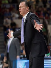 FGCU head coach Joe Dooley signals to his players in