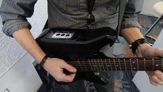 The Fusion Guitar has a dock to plug in an iPhone, to play along with backing tracks, instructional videos or use apps to alter the sound of the instrument. The retail price is $1,200