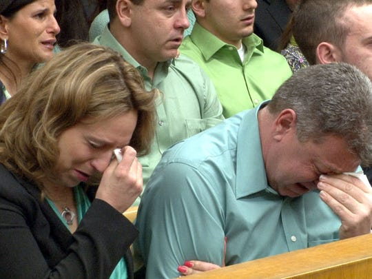 Ron and Christine Holt cry as Anthony Senatore addresses a judge Thursday before being sentenced for his role in the fatal shooting of their 6-year-old son Brandon, who was shot to death.