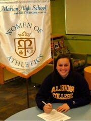 The big day finally arrives for Marian senior Megan Bricely, signing her national letter of intent Wednesday to play soccer at Albion College.