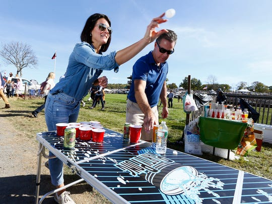Larissa and Tim Reick of Watching playing beer pong