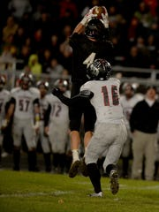 Winchester's Elias Gates catches a pass against Eastbrook's