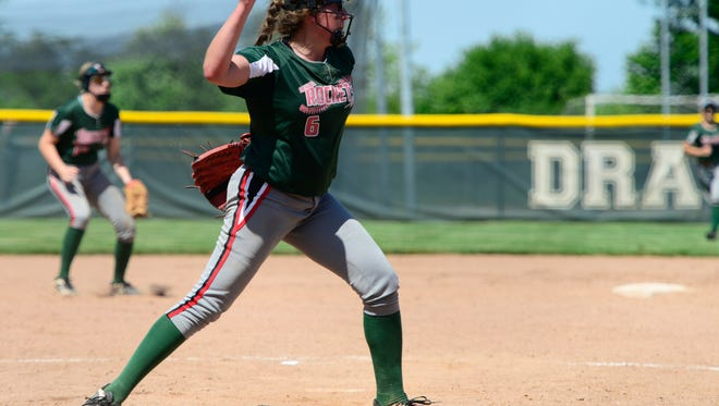 Oak Harbor's Ashley Riley throws to first after fielding a grounder in the circle Thursday against Keystone.