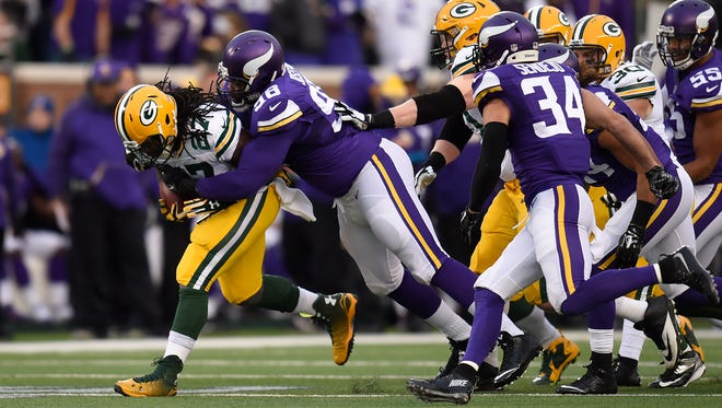 Green Bay Packers running back Eddie Lacy (27) fights for extra yards while being tackled by Minnesota Vikings defensive tackle Linval Joseph (98) in the first quarter during Sunday's game at TCF Bank Stadium in Minneapolis, Minn.