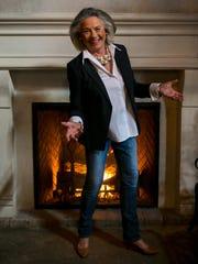 Jan Geddes wears a navy blue tie-back jacket; white
