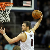 Jan 28, 2015; Cleveland, OH, USA; Cleveland Cavaliers forward Kevin Love (0) rebounds in the fourth quarter against the Portland Trail Blazers at Quicken Loans Arena. Mandatory Credit: David Richard-USA TODAY Sports