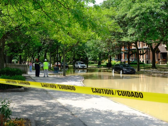Detroit Water and Sewerage crews work on the flooding