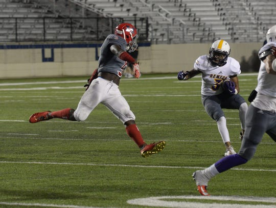 Haughton's Lavanta' Gipson moves in for the stop on
