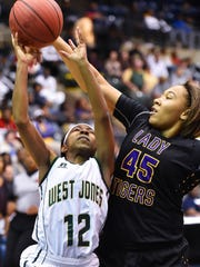 Hattiesburg's Melyia Grayson (45) blocks the shot of West Jones Miesha Bender (12) during the MHSAA Girls 5A Championship Game held at The Coliseum in Jackson.