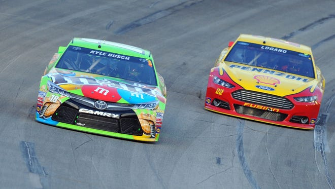 Kyle Busch passed Joey Logano with 19 laps left to win at Kentucky Speedway.