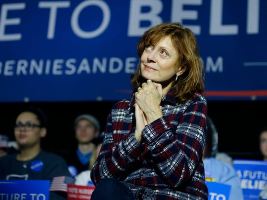 Actress Susan Sarandon watches as Democratic presidential candidate Bernie Sanders speaks at a campaign event in Mason City, Iowa, on Jan. 27, 2016.