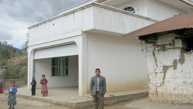 With money that three of his children working in the U.S. sent him, Alejandro Rojas was able to afford an extravagant house in this desolate area of Guatemala. But Rojas, who struggles to feed his family, cannot afford to live in the house, so he rents it out and lives in a nearby shack.