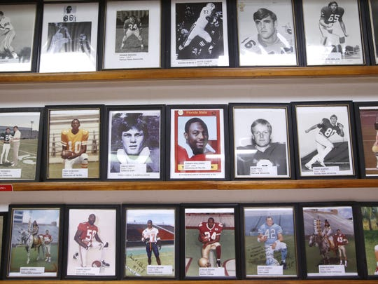 "Photos of Leon High School football greats line the walls of the school's indoor practice facility known as the ""old gym"" on Monday, July 27, 2015."