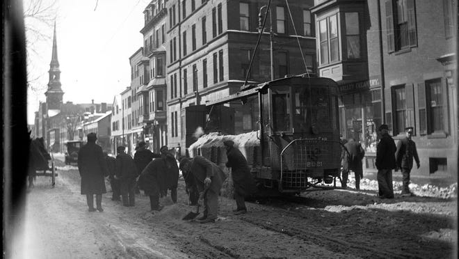 Workers clear Shawmut Street in the South End after a snowstorm in 1916. Learn more from Digital Commonwealth at www.digitalcommonwealth.org.